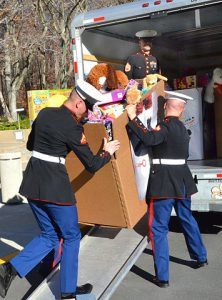 Marines loading toys for Toys for Tots toy drive.